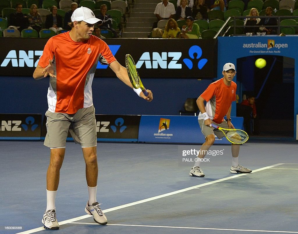 Mike Bryan (L) and his brother Bob of the US compete against the Netherland's Robin Haase and Igor Sijsling during the men's doubles final on day 13 of the Australian Open tennis tournament in Melbourne on January 26, 2013. AFP PHOTO / PAUL CROCK IMAGE STRICTLY RESTRICTED TO EDITORIAL USE - STRICTLY NO COMMERCIAL USE