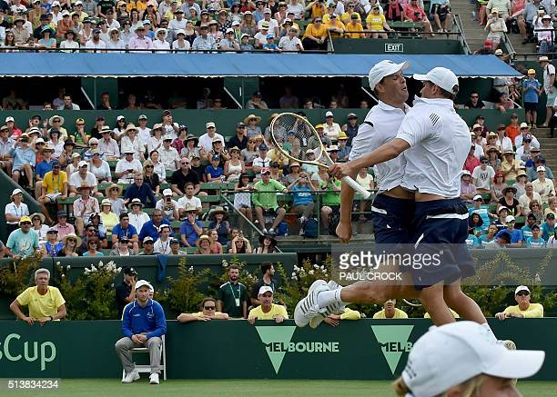 Mike Bryan Bryan and Bob Bryan of the US react after beating Lletyon Hewitt and John Peers of Australia in their men's doubles match at the World...