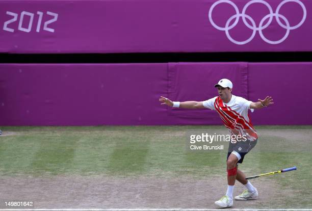 Mike Bryan celebrates with Bob Bryan after defeating JoWilfried Tsonga and Michael Llodra of France in their Men's Doubles Tennis final match on Day...