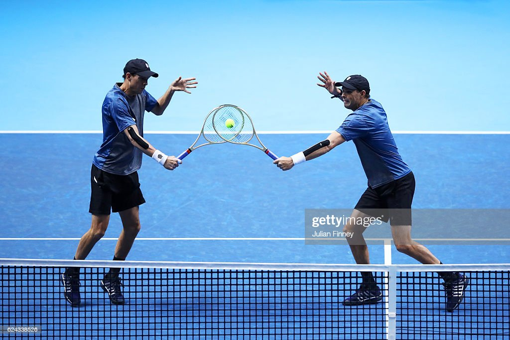 Mike Bryan of the United States and Bob Bryan of the United States attempt to volley at the net during their men's doubles semi-final match against Henri Kontinen of Finland and John Peers of Australia on day seven of the ATP World Tour Finals at O2 Arena on November 19, 2016 in London, England.