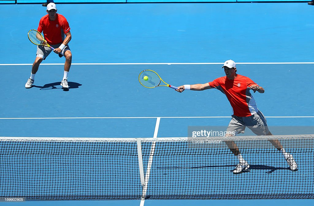 Mike Bryan of the United States plays a forehand in his fourth round doubles match with Bob Bryan of the United States against Daniele Bracciali of Italy and Lukas Dloughy of the Czech Republic during day ten of the 2013 Australian Open at Melbourne Park on January 23, 2013 in Melbourne, Australia.