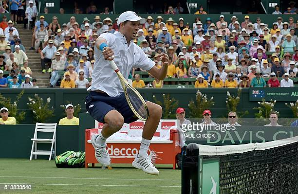 Mike Bryan of the US reacts after winning a point against Sam Groth and John Peers of Australia during their men's doubles match at the World Group...