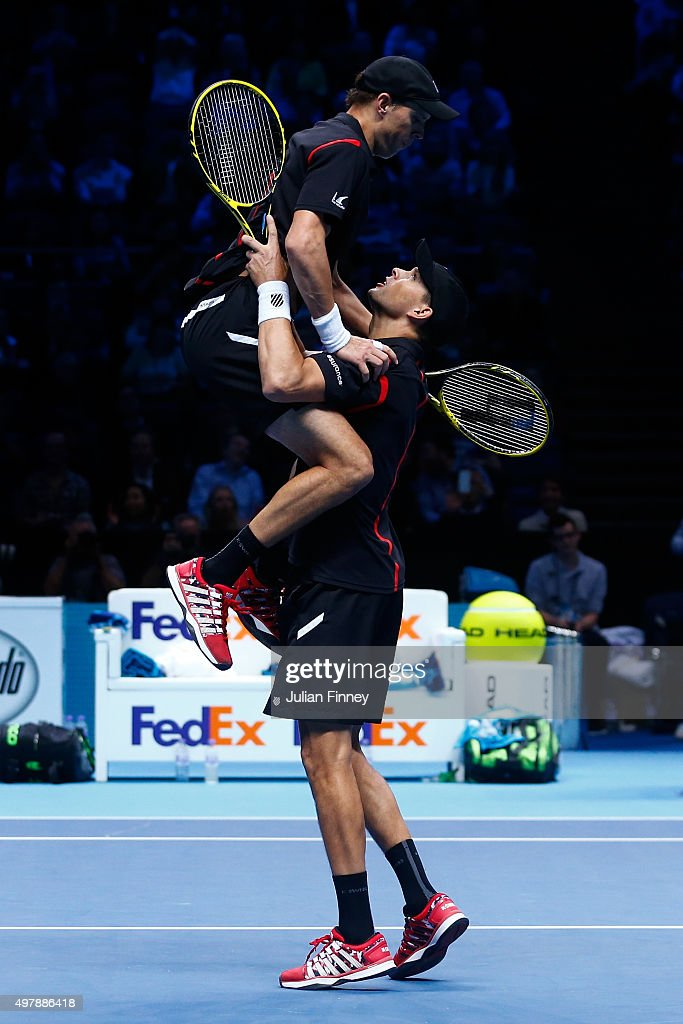 Mike Bryan of the USA and Bob Bryan of the USA celebrate their victory in their men's doubles match against Jamie Murray of Great Britain and John Peers of Australia during day five of the Barclays ATP World Tour Finals at the O2 Arena on November 19, 2015 in London, England.