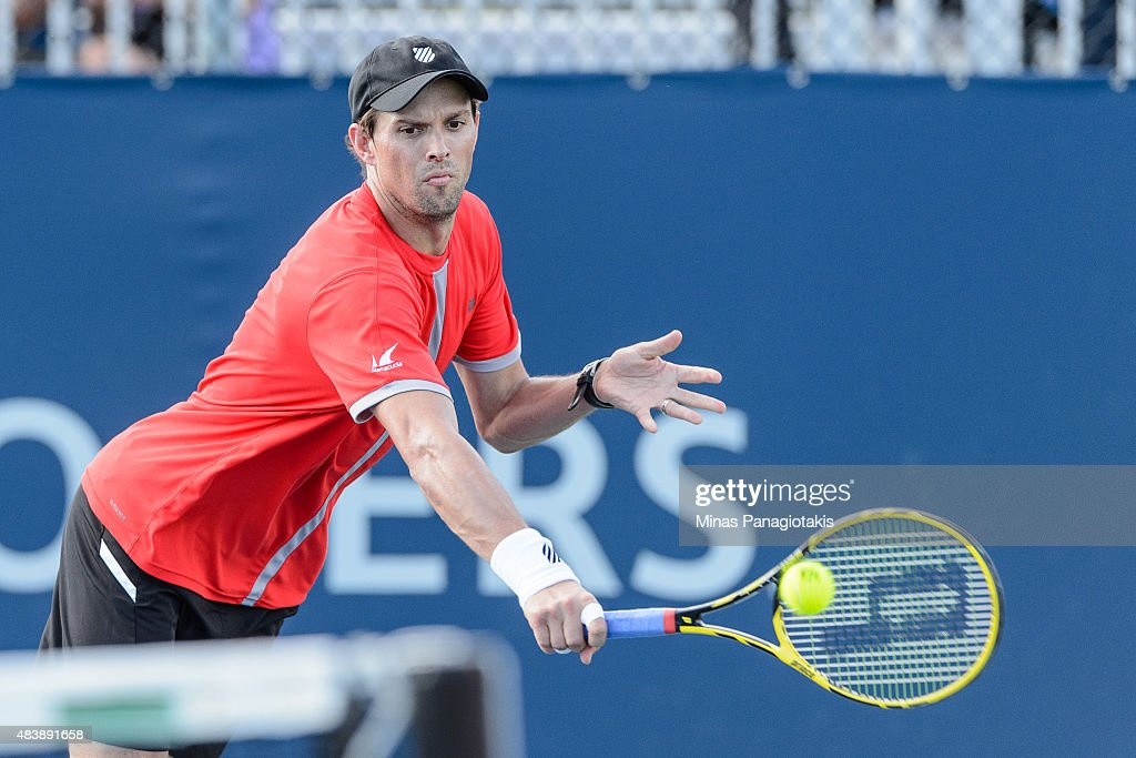 <a gi-track='captionPersonalityLinkClicked' href=/galleries/search?phrase=Mike+Bryan+-+Tennis+Player&family=editorial&specificpeople=204456 ng-click='$event.stopPropagation()'>Mike Bryan</a> of the USA hits a return against Feliciano Lopez of Spain and Max Mirnyi of Belarus during day four of the Rogers Cup at Uniprix Stadium on August 13, 2015 in Montreal, Quebec, Canada.