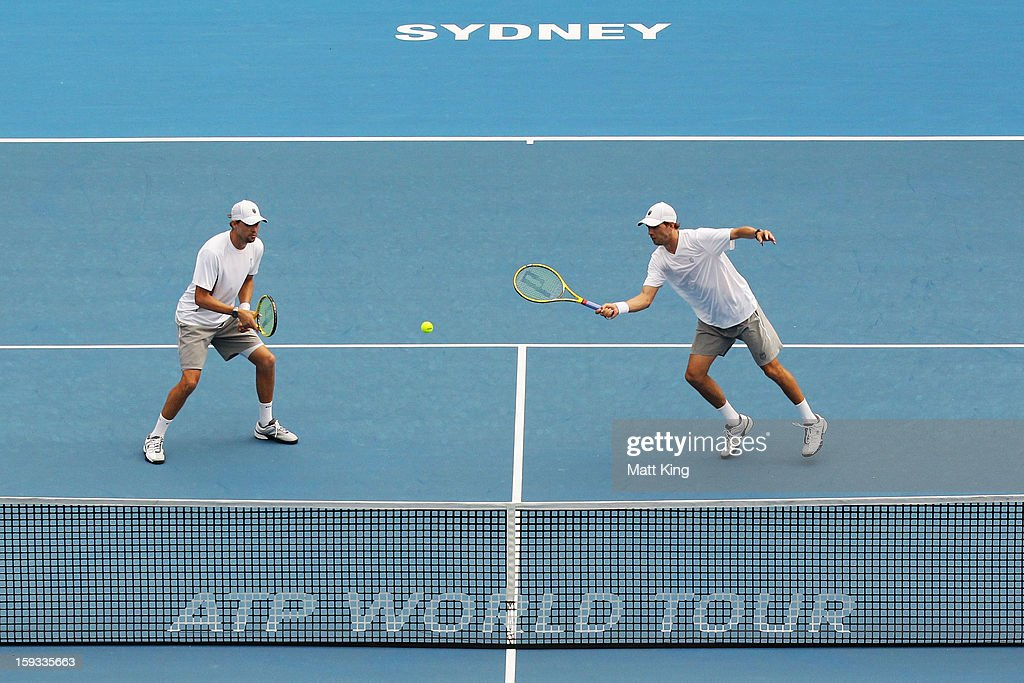 Mike Bryan (R) of USA plays a volley at the net playing with Bob Bryan (L) against Max Mirnyi of Belarus and Horia Tecau of Romania during day seven of the Sydney International at Sydney Olympic Park Tennis Centre on January 12, 2013 in Sydney, Australia.
