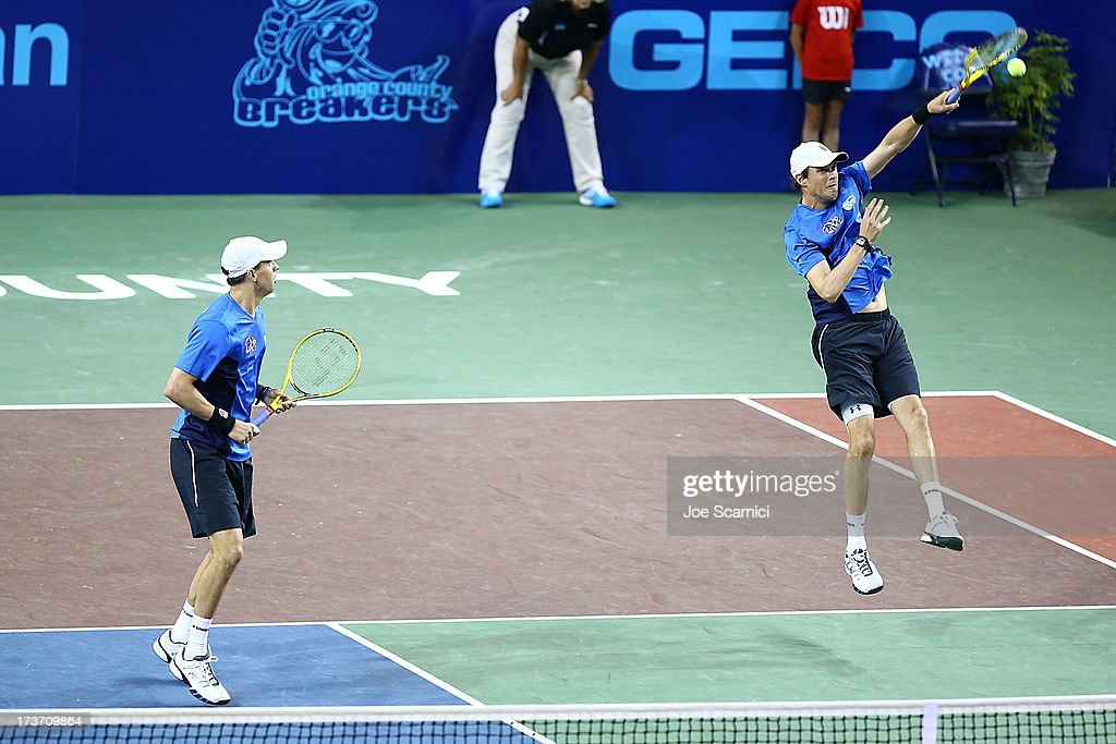 <a gi-track='captionPersonalityLinkClicked' href=/galleries/search?phrase=Mike+Bryan+-+Tennis+Player&family=editorial&specificpeople=204456 ng-click='$event.stopPropagation()'>Mike Bryan</a> returns a shot as <a gi-track='captionPersonalityLinkClicked' href=/galleries/search?phrase=Bob+Bryan+-+Tennis+Player&family=editorial&specificpeople=203335 ng-click='$event.stopPropagation()'>Bob Bryan</a> looks on as the Texas Wild compete against the Orange County Breakers on July 16, 2013 in Newport Beach, California.