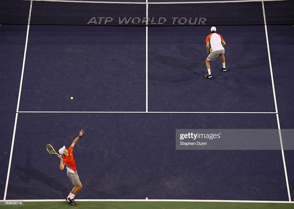Mike Bryan serves over Mike Bryan to Treat Huey of the Philippines and Jerzy Janowicz of Poland during the men's doubles final during day 11 of the BNP Paribas Open at Indian Wells Tennis Garden on March 16, 2013 in Indian Wells, California.