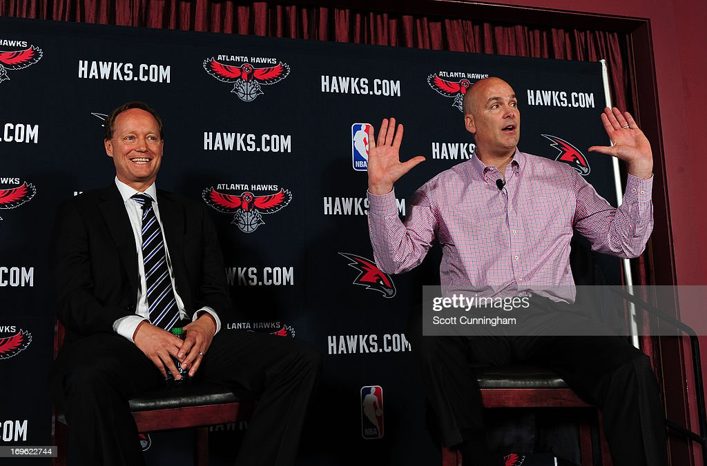 Mike Budenholzer (L) is introduced by General Manager Danny Ferry as the new Head Coach of the Atlanta Hawks during a press conference on May 29, 2013 at Philips Arena in Atlanta, Georgia.