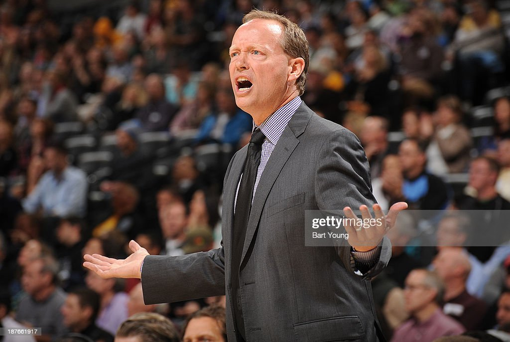 Mike Budenholzer of the Atlanta Hawks calls a play against the Denver Nuggets on November 7, 2013 at the Pepsi Center in Denver, Colorado.