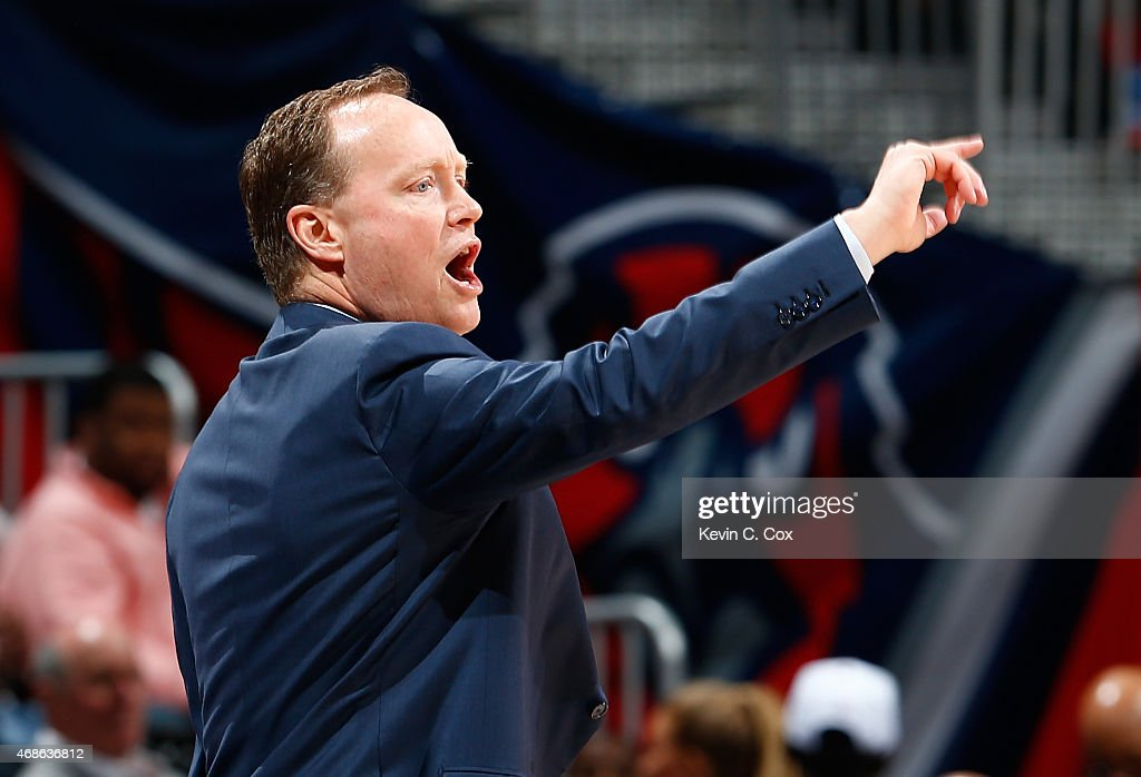 Mike Budenholzer of the Atlanta Hawks calls out to his players during the game against the Brooklyn Nets at Philips Arena on April 4 2015 in Atlanta...