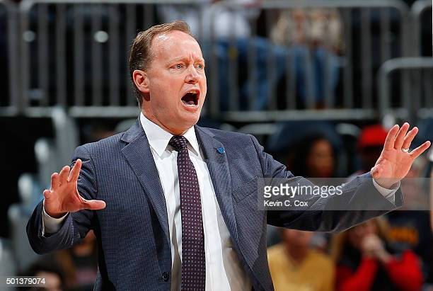 Mike Budenholzer of the Atlanta Hawks calls out to his team during the game against the Miami Heat at Philips Arena on December 14 2015 in Atlanta...