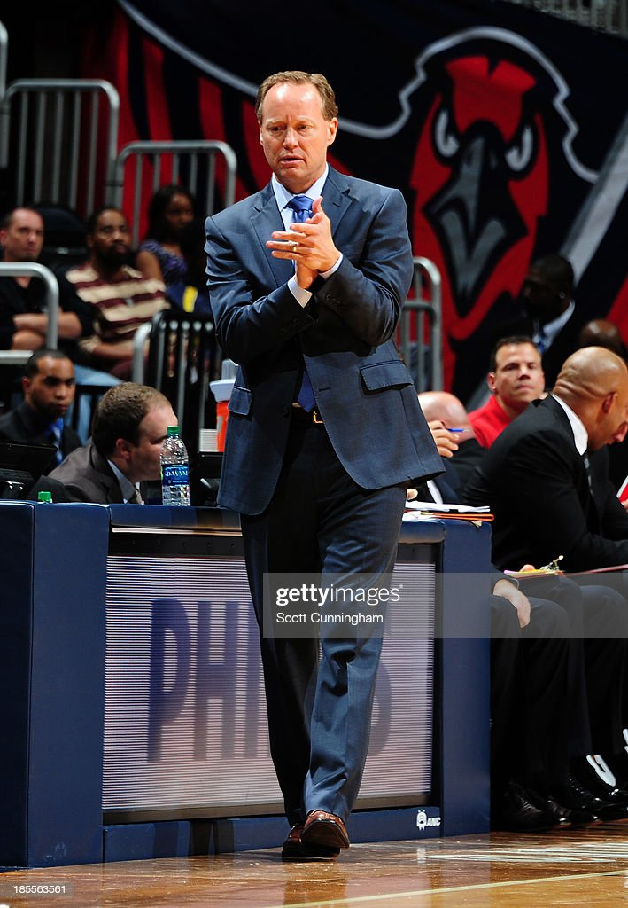 <a gi-track='captionPersonalityLinkClicked' href=/galleries/search?phrase=Mike+Budenholzer&family=editorial&specificpeople=2332367 ng-click='$event.stopPropagation()'>Mike Budenholzer</a> of the Atlanta Hawks cheers his team on from the bench during the game against the Memphis Grizzlies on October 20, 2013 at Philips Arena in Atlanta, Georgia.