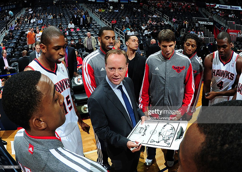 <a gi-track='captionPersonalityLinkClicked' href=/galleries/search?phrase=Mike+Budenholzer&family=editorial&specificpeople=2332367 ng-click='$event.stopPropagation()'>Mike Budenholzer</a> of the Atlanta Hawks draws up a play during the game against the San Antonio Spurs on October 17, 2013 at Philips Arena in Atlanta, Georgia.