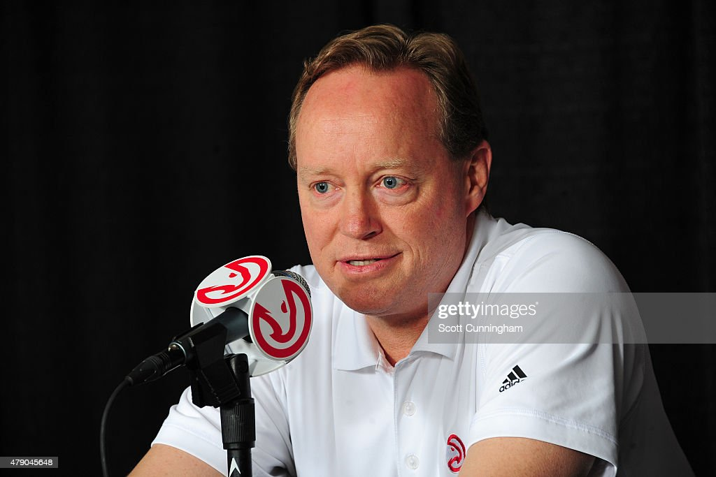 Mike Budenholzer of the Atlanta Hawks introduces Tim Hardaway Jr as a new member of the team during a press conference on June 29 2015 at Philips...