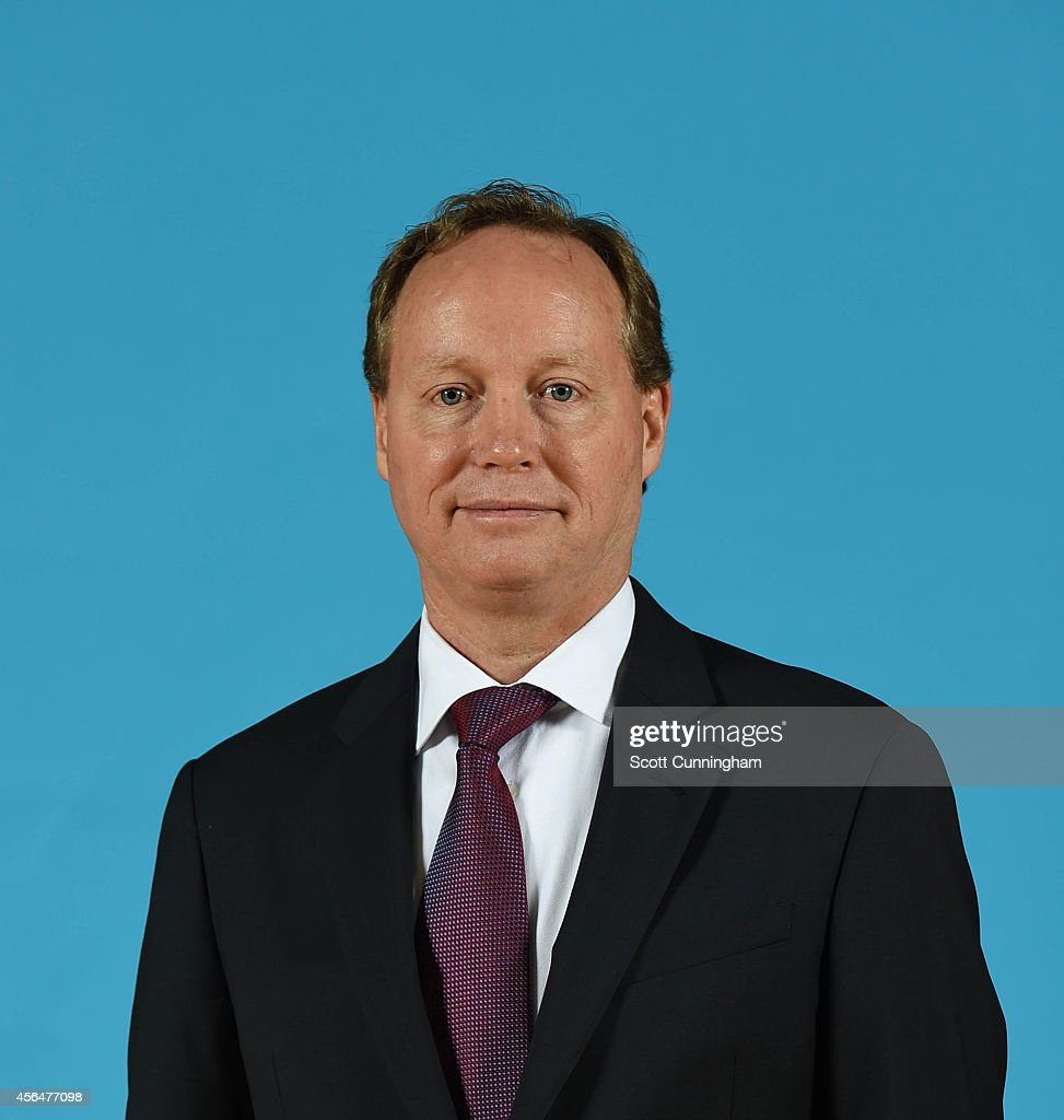 Mike Budenholzer of the Atlanta Hawks poses for a photograph during the Atlanta Hawks Media Day on September 29 2014 at Philips Arena in Atlanta...