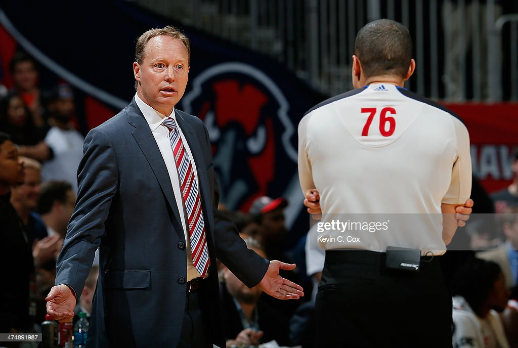 Mike Budenholzer of the Atlanta Hawks questions referee Steve Anderson #76 in the final seconds of their 107-103 loss to the Chicago Bulls at Philips Arena on February 25, 2014 in Atlanta, Georgia.