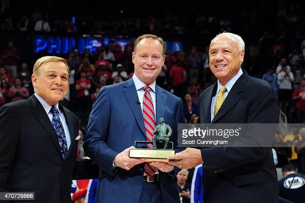 Mike Budenholzer of the Atlanta Hawks receives the 2015 NBA Coach of the Year Award from former Atlanta Hawks coaches Miek Fratello and Lenny Wilkens...