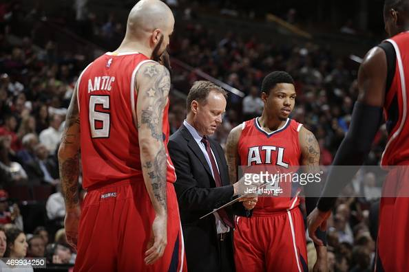 Mike Budenholzer of the Atlanta Hawks speaks to the team during a game against the Chicago Bulls on April 15 2015 at the United Center in Chicago...