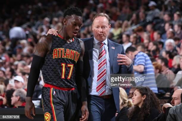 Mike Budenholzer of the Atlanta Hawks talks with Dennis Schroder of the Atlanta Hawks during the game against the Portland Trail Blazers on FEBRUARY...
