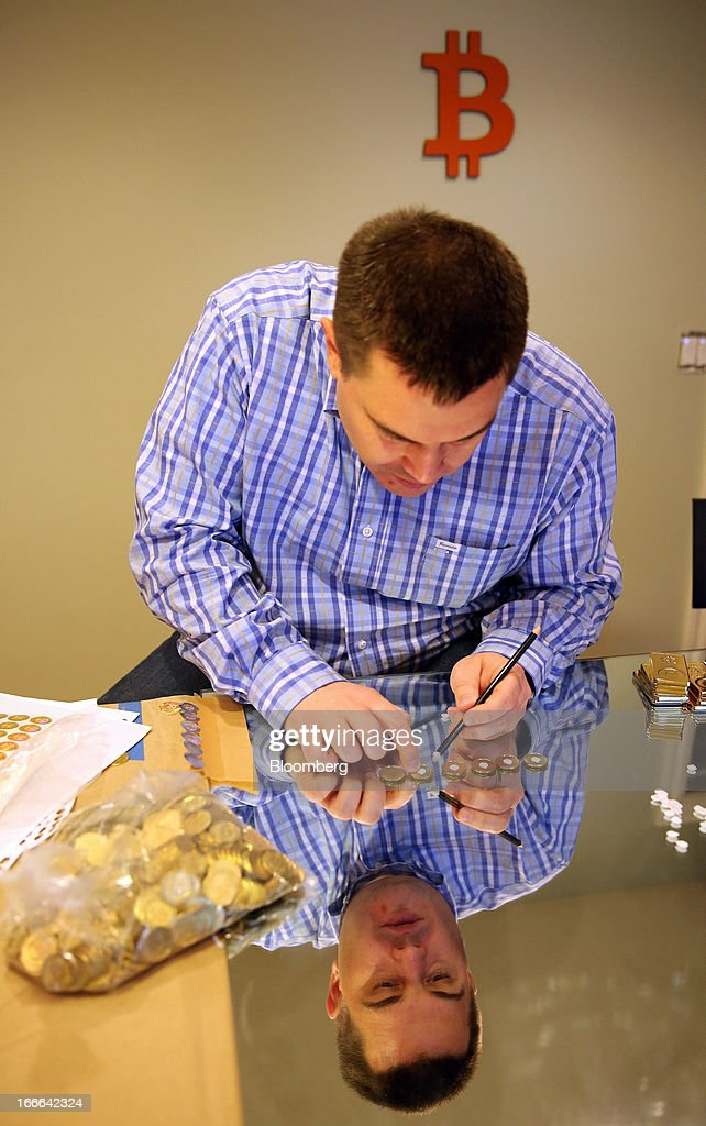 Mike Caldwell, of Casascius, makes Bitcoins at his home in Sandy, Utah, U.S., on Friday, April 12, 2013. Created four years ago by a person or group using the name Satoshi Nakamoto, Bitcoin is a virtual currency that can be used to buy and sell a broad range of items -- from cupcakes to electronics to illegal narcotics. Photographer: George Frey/Bloomberg via Getty Images