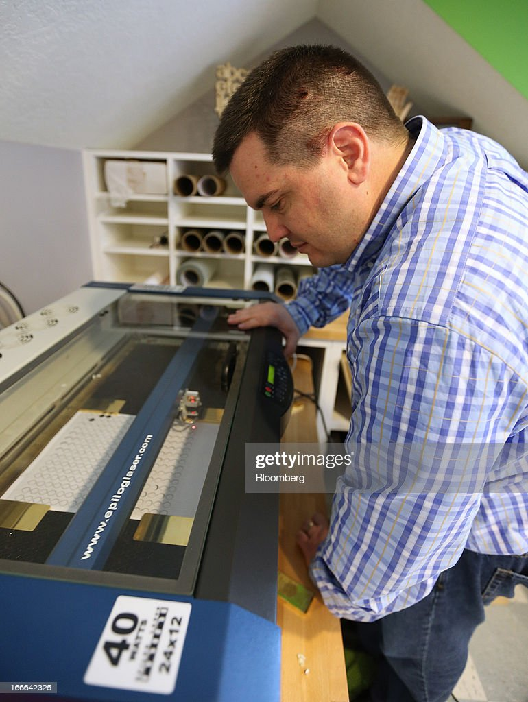Mike Caldwell, of Casascius, prints holograms for Bitcoins that he makes at his home in Sandy, Utah, U.S., on Friday, April 12, 2013. Created four years ago by a person or group using the name Satoshi Nakamoto, Bitcoin is a virtual currency that can be used to buy and sell a broad range of items -- from cupcakes to electronics to illegal narcotics. Photographer: George Frey/Bloomberg via Getty Images