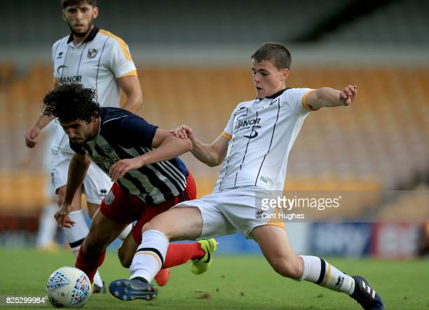 Mike Calverley of Port Vale tackles Ahmed Hegazy of West Bromwich Albion during the pre season friendly match at Vale Park on August 1 2017 in...