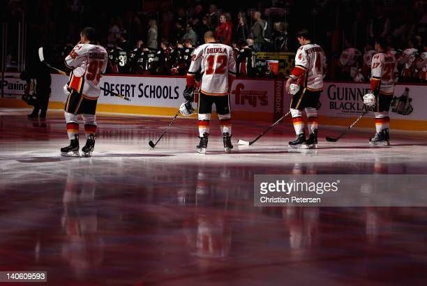 Mike Cammalleri Jarome Iginla Jay Bouwmeester and Derek Smith of the Calgary Flames stand attended for the Canadien National Anthem before the NHL...