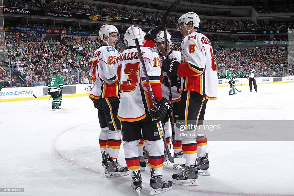 <a gi-track='captionPersonalityLinkClicked' href=/galleries/search?phrase=Mike+Cammalleri&family=editorial&specificpeople=634009 ng-click='$event.stopPropagation()'>Mike Cammalleri</a> #13, <a gi-track='captionPersonalityLinkClicked' href=/galleries/search?phrase=Joe+Colborne&family=editorial&specificpeople=5370968 ng-click='$event.stopPropagation()'>Joe Colborne</a> #8, Sean Monahan #23 and the Calgary Flames celebrate a goal against the Dallas Stars at the American Airlines Center on March 14, 2014 in Dallas, Texas.