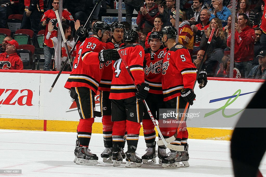 <a gi-track='captionPersonalityLinkClicked' href=/galleries/search?phrase=Mike+Cammalleri&family=editorial&specificpeople=634009 ng-click='$event.stopPropagation()'>Mike Cammalleri</a> #13, <a gi-track='captionPersonalityLinkClicked' href=/galleries/search?phrase=Mark+Giordano&family=editorial&specificpeople=696867 ng-click='$event.stopPropagation()'>Mark Giordano</a> #5, <a gi-track='captionPersonalityLinkClicked' href=/galleries/search?phrase=Kris+Russell&family=editorial&specificpeople=879805 ng-click='$event.stopPropagation()'>Kris Russell</a> #4 and teammates of the Calgary Flames celebrate a goal against the Ottawa Senators at Scotiabank Saddledome on March 5, 2014 in Calgary, Alberta, Canada.
