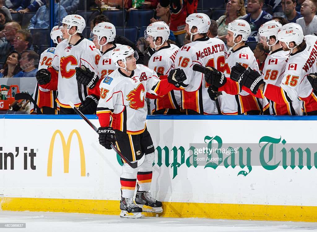 <a gi-track='captionPersonalityLinkClicked' href=/galleries/search?phrase=Mike+Cammalleri&family=editorial&specificpeople=634009 ng-click='$event.stopPropagation()'>Mike Cammalleri</a> #13 of the Calgary Flames celebrates his goal with teammates against the Tampa Bay Lightning during the first period at the Tampa Bay Times Forum on April 3, 2014 in Tampa, Florida.