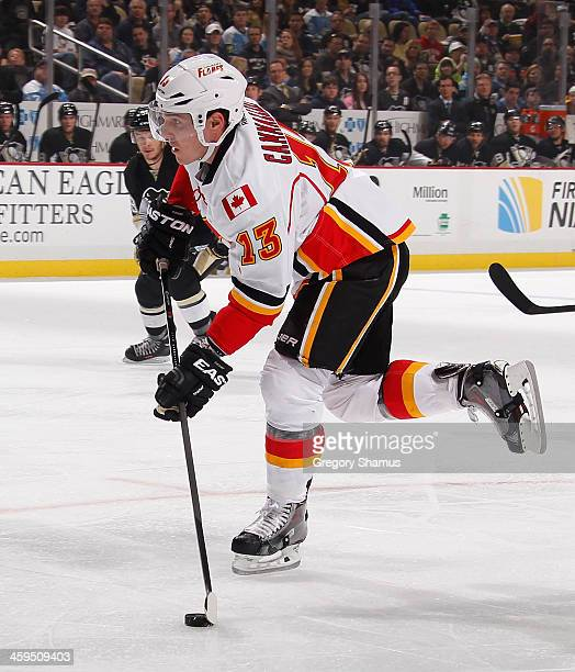 Mike Cammalleri of the Calgary Flames moves the puck against the Pittsburgh Penguins on December 21 2013 at Consol Energy Center in Pittsburgh...
