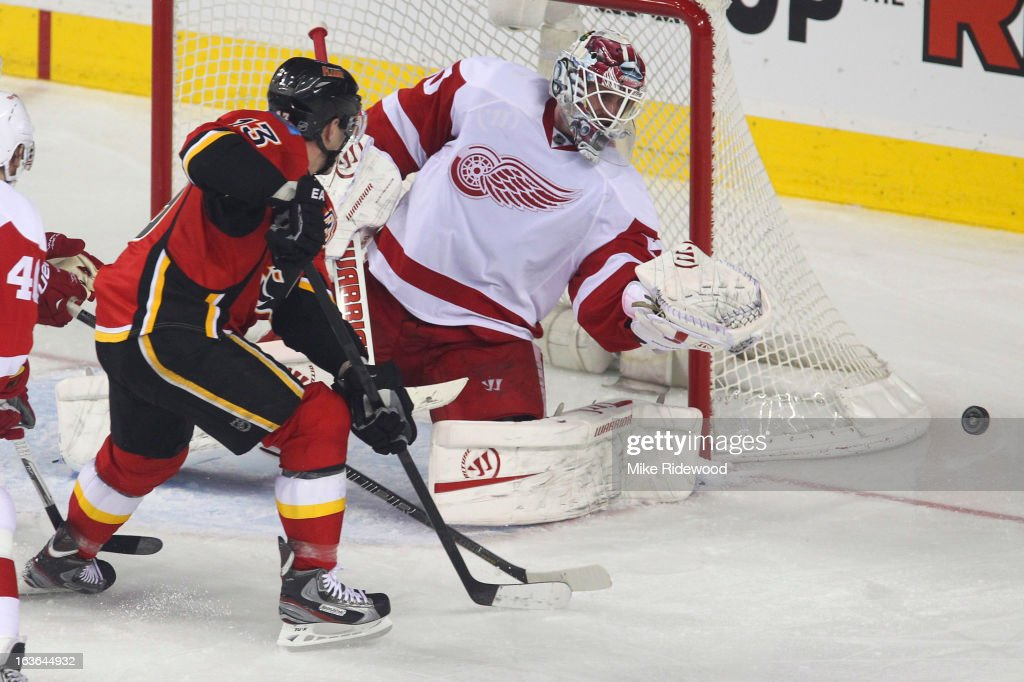 <a gi-track='captionPersonalityLinkClicked' href=/galleries/search?phrase=Mike+Cammalleri&family=editorial&specificpeople=634009 ng-click='$event.stopPropagation()'>Mike Cammalleri</a> #13 of the Calgary Flames shoots wide past <a gi-track='captionPersonalityLinkClicked' href=/galleries/search?phrase=Jonas+Gustavsson&family=editorial&specificpeople=886789 ng-click='$event.stopPropagation()'>Jonas Gustavsson</a> #50 of the Detroit Red Wings during third period NHL action on March 13, 2013 at the Scotiabank Saddledome in Calgary, Alberta, Canada. Calgary Flames defeated the Detroit Red Wings 5 - 2.