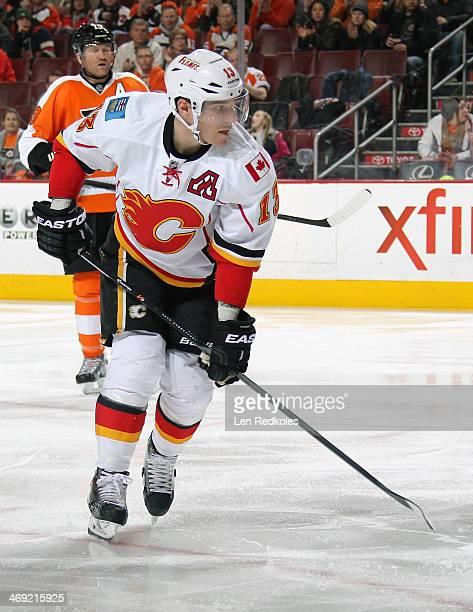 Mike Cammalleri of the Calgary Flames skates against Scott Hartnell of the Philadelphia Flyers on February 8 2014 at the Wells Fargo Center in...