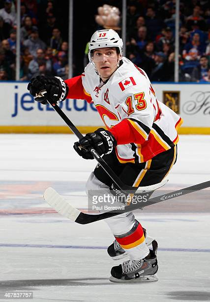 Mike Cammalleri of the Calgary Flames skates during an NHL hockey game against the New York Islanders at Nassau Veterans Memorial Coliseum on...