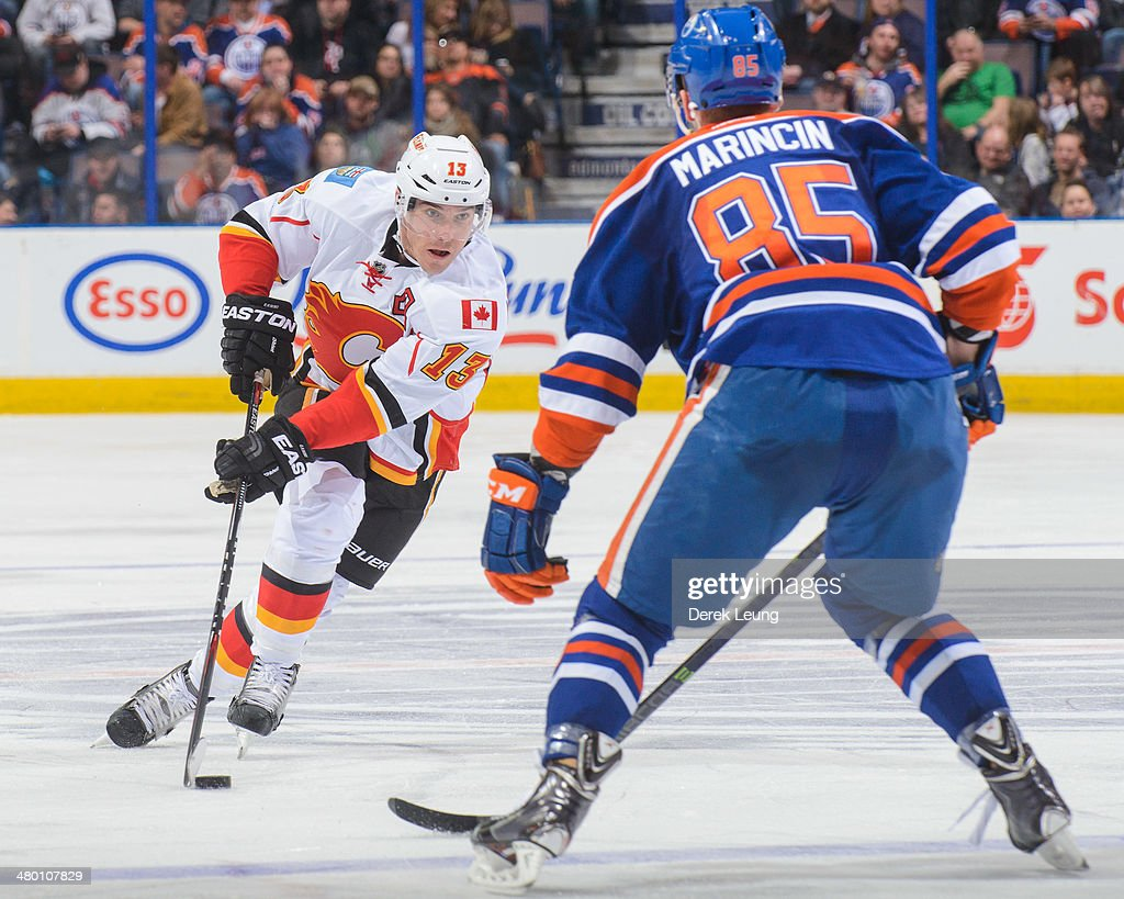 <a gi-track='captionPersonalityLinkClicked' href=/galleries/search?phrase=Mike+Cammalleri&family=editorial&specificpeople=634009 ng-click='$event.stopPropagation()'>Mike Cammalleri</a> #13 of the Calgary Flames skates the puck against Martin Marincin #85 of the Edmonton Oilers during an NHL game at Rexall Place on March 22, 2014 in Edmonton, Alberta, Canada. The Flames defeated the Oilers 8-1.