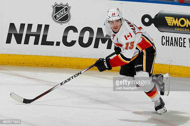 Mike Cammalleri of the Calgary Flames skates up ice against the Florida Panthers at the BBT Center on April 4 2014 in Sunrise Florida The Flames...