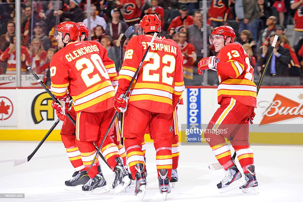 <a gi-track='captionPersonalityLinkClicked' href=/galleries/search?phrase=Mike+Cammalleri&family=editorial&specificpeople=634009 ng-click='$event.stopPropagation()'>Mike Cammalleri</a> #13 of the Calgary Flames smiles after his teammate Curtis Glencross #20 scored the winning goal against the Phoenix Coyotes during an NHL game at Scotiabank Saddledome on February 24, 2013 in Calgary, Alberta, Canada.