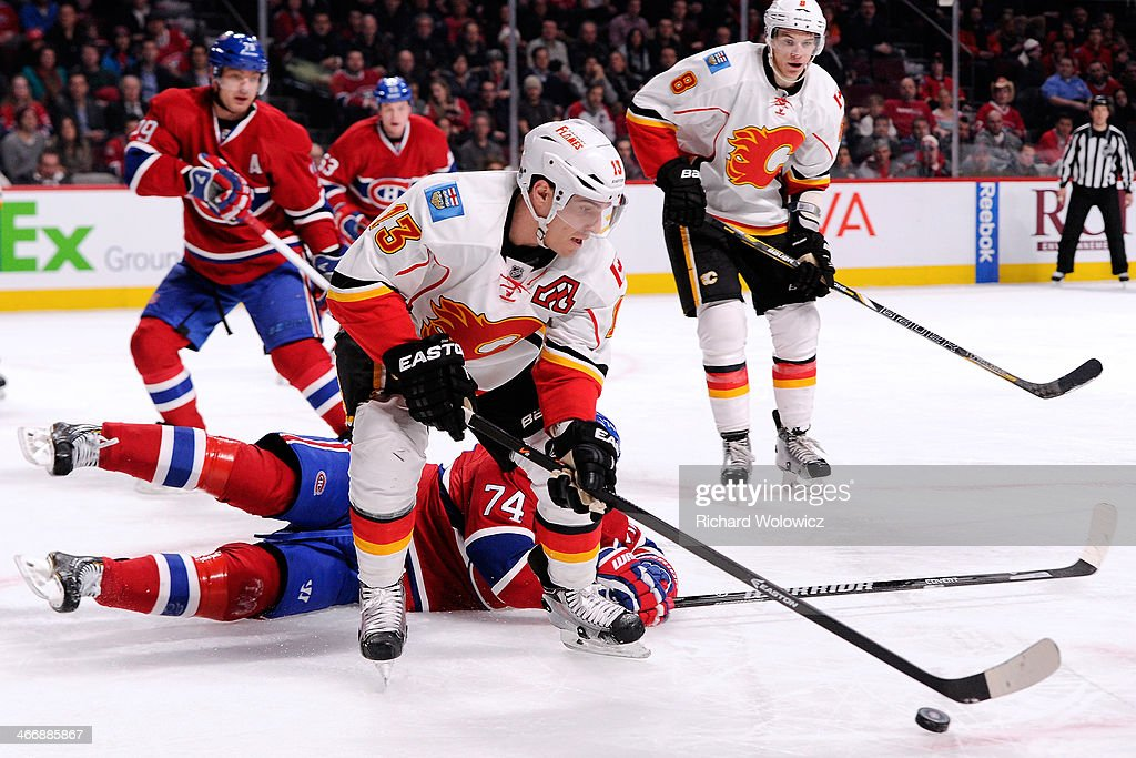 <a gi-track='captionPersonalityLinkClicked' href=/galleries/search?phrase=Mike+Cammalleri&family=editorial&specificpeople=634009 ng-click='$event.stopPropagation()'>Mike Cammalleri</a> #13 of the Calgary Flames stick handles the puck in front of Alexei Emelin #74 of the Montreal Canadiens during the NHL game at the Bell Centre on February 4, 2014 in Montreal, Quebec, Canada. The Canadiens defeated the Flames 2-0.