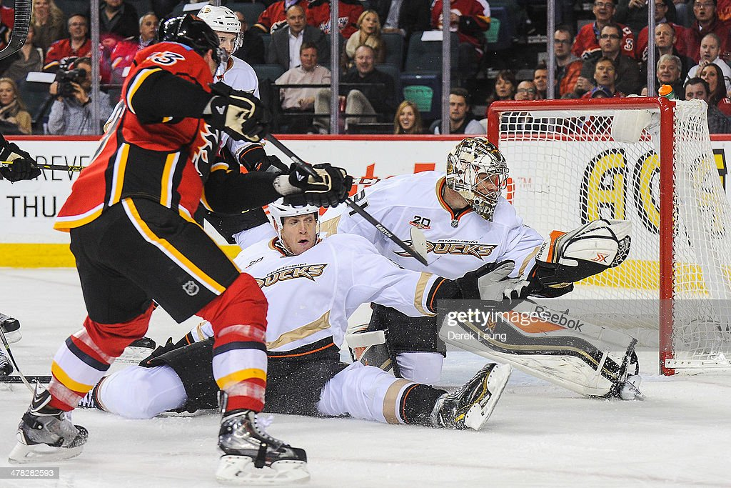 <a gi-track='captionPersonalityLinkClicked' href=/galleries/search?phrase=Mike+Cammalleri&family=editorial&specificpeople=634009 ng-click='$event.stopPropagation()'>Mike Cammalleri</a> #13 of the Calgary Flames takes a shot at the net of <a gi-track='captionPersonalityLinkClicked' href=/galleries/search?phrase=Frederik+Andersen&family=editorial&specificpeople=6605243 ng-click='$event.stopPropagation()'>Frederik Andersen</a> #31 of the Anaheim Ducks during an NHL game at Scotiabank Saddledome on March 12, 2014 in Calgary, Alberta, Canada. The Flames defeated the Ducks 7-2.