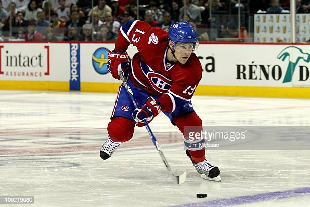 Mike Cammalleri of the Montreal Canadiens handles the puck in Game 3 of the Eastern Conference Finals during the 2010 NHL Stanley Cup Playoffs at...