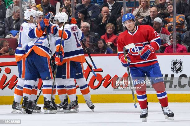 Mike Cammalleri of the Montreal Canadiens skates away as David Ullstrom Travis Hamonic Mark Streit John Tavares and PA Parenteau of the New York...