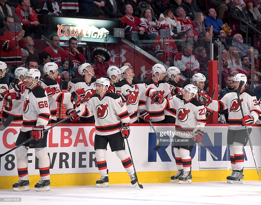 Mike Cammalleri of the New Jersey Devils celebrates with the bench after scoring a goal against of the Montreal Canadiens in the NHL game at the Bell...