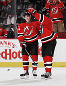 Mike Cammalleri of the New Jersey Devils is congratulated by Andy Greene after scoring a third period goal during the game against the San Jose...