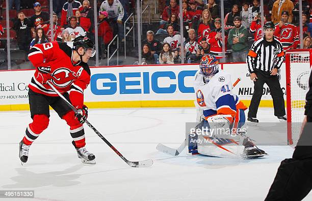 Mike Cammalleri of the New Jersey Devils scores the game deciding goal in a shootout against the New York Islanders during the game at the Prudential...