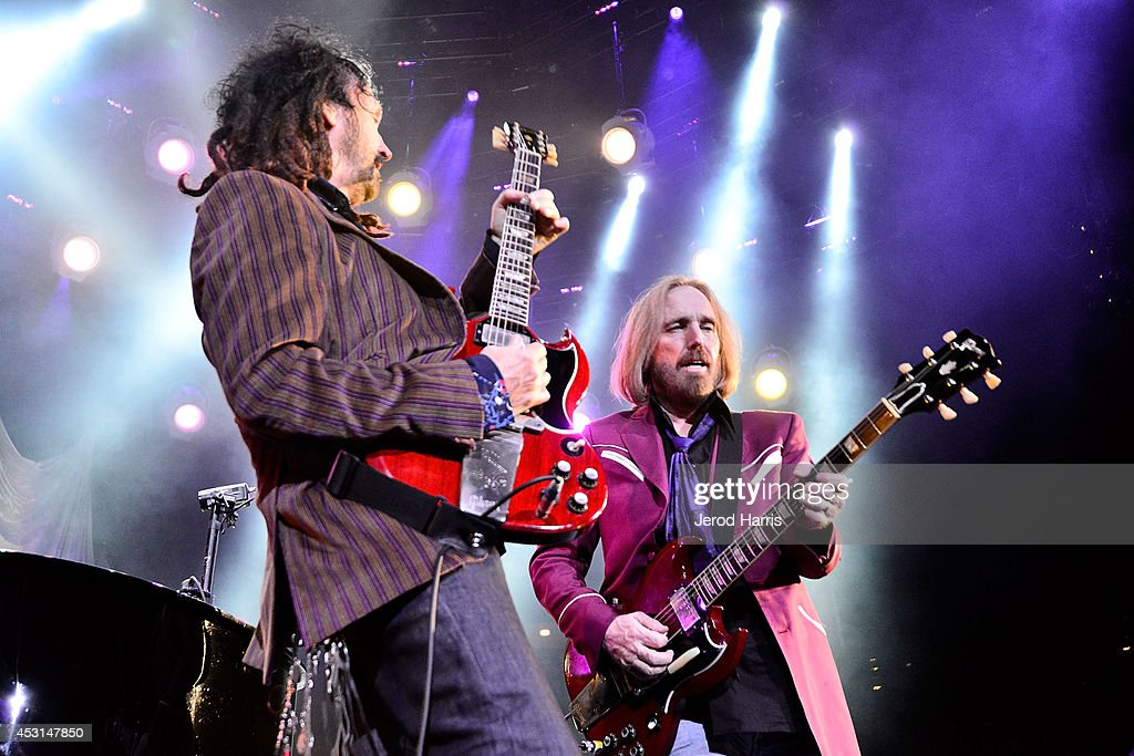 Mike Campbell and Tom Petty perform at Viejas Arena on August 3, 2014 in San Diego, California.