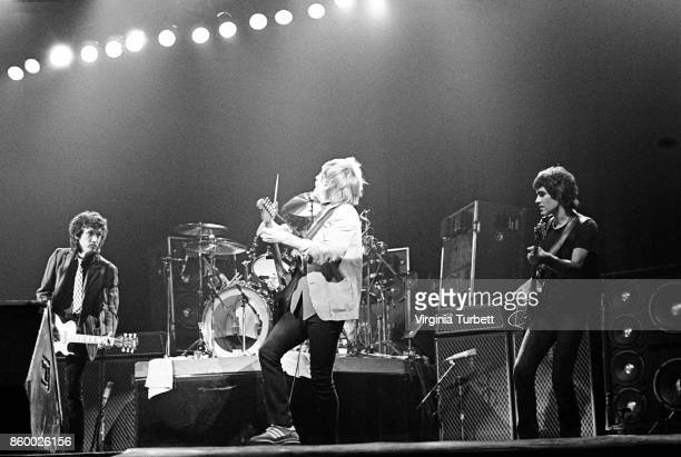 Mike Campbell Tom Petty and Ron Blair of Tom Petty and the Heartbreakers perform on stage at Hammersmith Odeon London 6th March 1980
