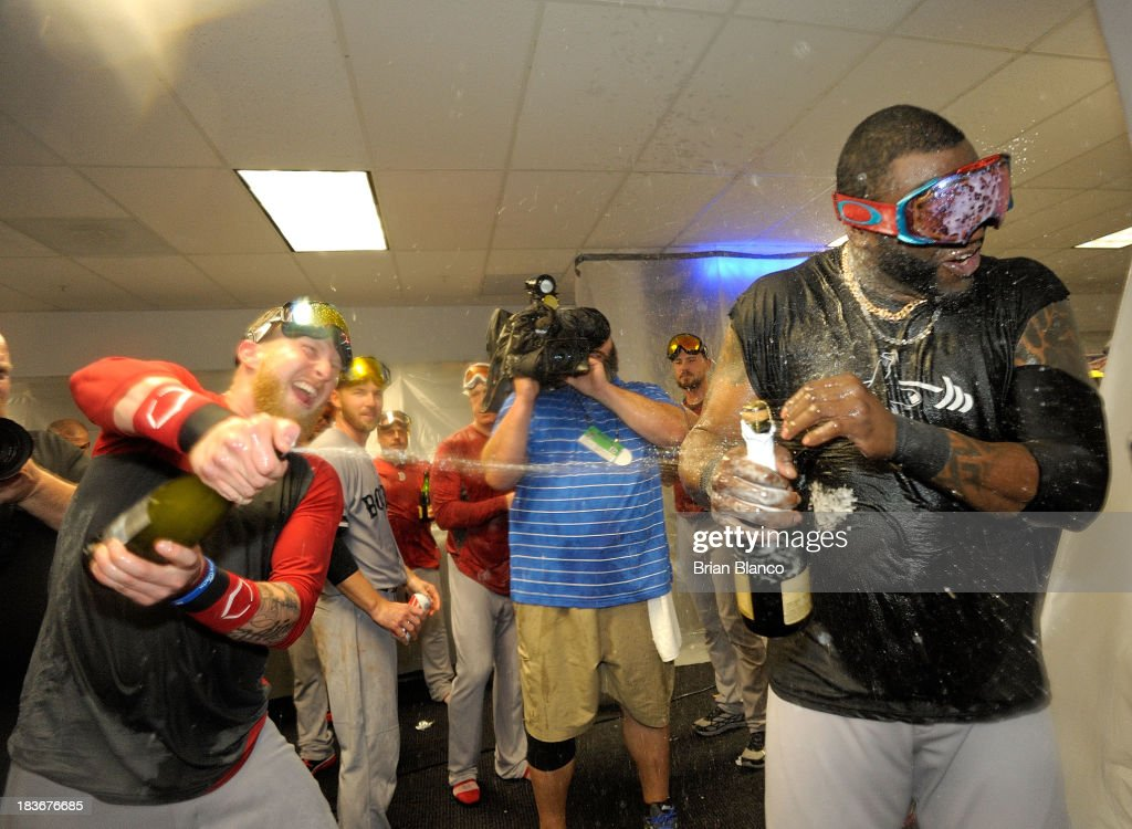 Mike Carp #37 and <a gi-track='captionPersonalityLinkClicked' href=/galleries/search?phrase=David+Ortiz&family=editorial&specificpeople=175825 ng-click='$event.stopPropagation()'>David Ortiz</a> #34 of the Boston Red Sox celebrates winning Game Four of the American League Division Series at Tropicana Field on October 8, 2013 in St Petersburg, Florida.