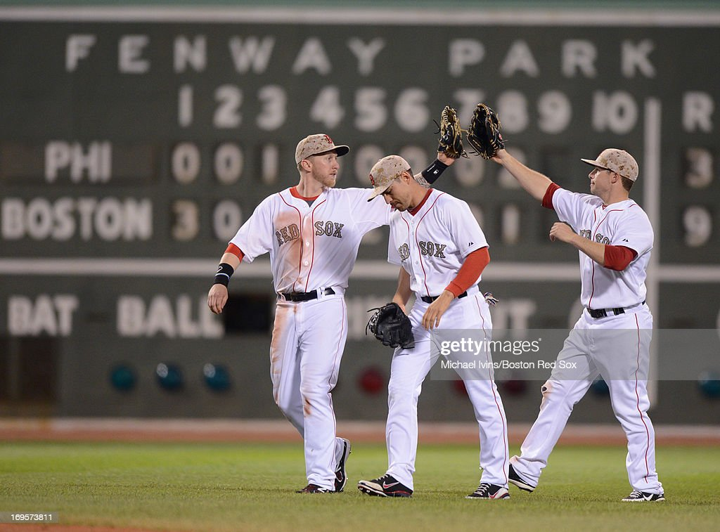 Mike Carp #37, <a gi-track='captionPersonalityLinkClicked' href=/galleries/search?phrase=Jacoby+Ellsbury&family=editorial&specificpeople=4172583 ng-click='$event.stopPropagation()'>Jacoby Ellsbury</a> #5 and <a gi-track='captionPersonalityLinkClicked' href=/galleries/search?phrase=Daniel+Nava&family=editorial&specificpeople=670454 ng-click='$event.stopPropagation()'>Daniel Nava</a> #29 of the Boston Red Sox celebrate a 9-3 win against the Philadelphia Phillies on May 27, 2013 at Fenway Park in Boston, Massachusetts.