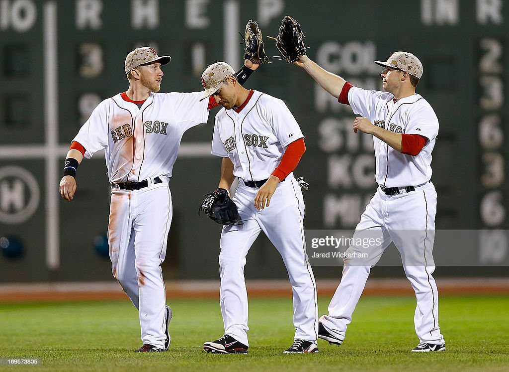 Mike Carp #37, <a gi-track='captionPersonalityLinkClicked' href=/galleries/search?phrase=Jacoby+Ellsbury&family=editorial&specificpeople=4172583 ng-click='$event.stopPropagation()'>Jacoby Ellsbury</a> #2, and <a gi-track='captionPersonalityLinkClicked' href=/galleries/search?phrase=Daniel+Nava&family=editorial&specificpeople=670454 ng-click='$event.stopPropagation()'>Daniel Nava</a> #29 of the Boston Red Sox congratulate each other following their 9-3 win against the Philadelphia Phillies during the interleague game on May 27, 2013 at Fenway Park in Boston, Massachusetts.