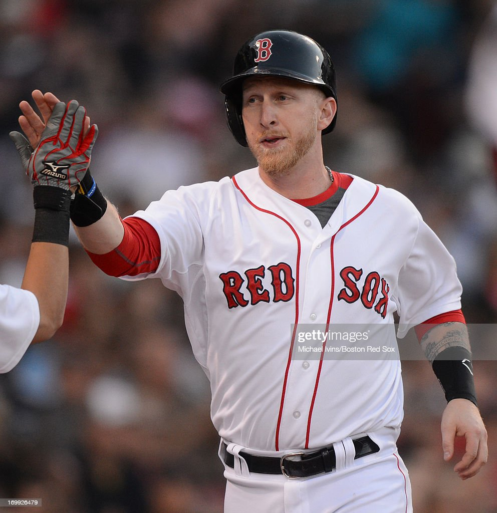Mike Carp #37 of the Boston Red Sox is congratulated after hitting a home run against the Texas Rangers in the fifth inning on June 4, 2013 at Fenway Park in Boston, Massachusetts.